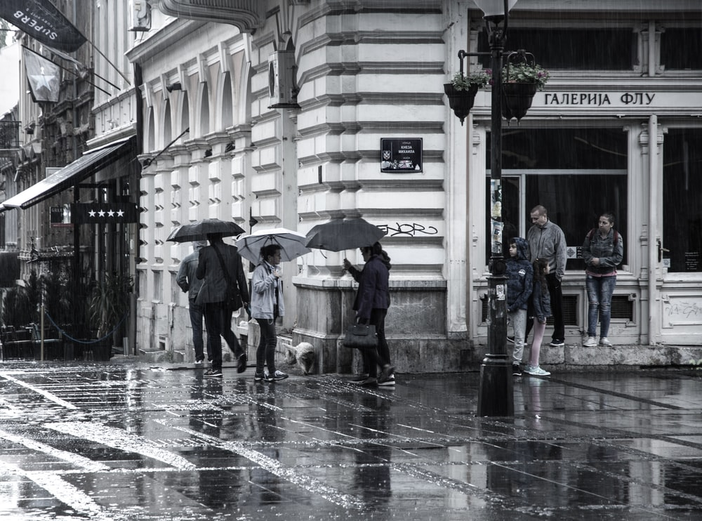 grayscale photography of people walking on street