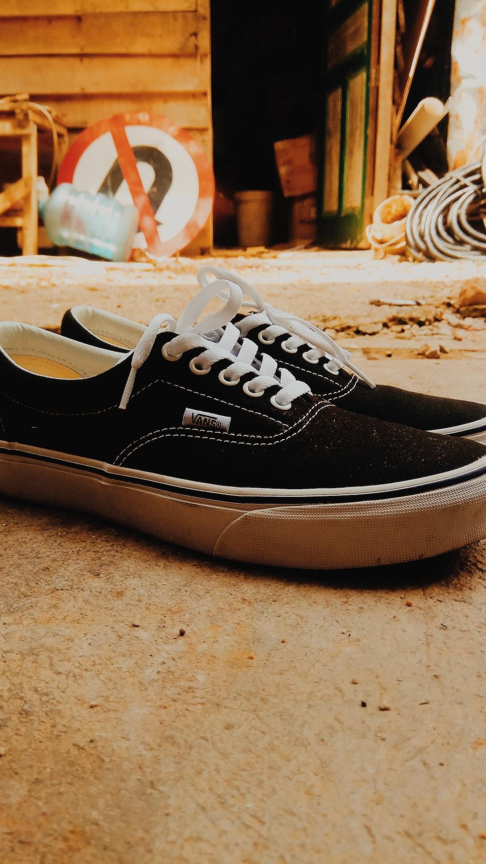 pair of black Vans low-top sneakers