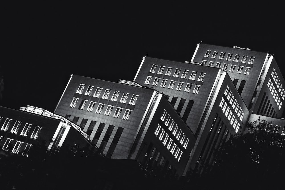 gray concrete buildings during night time