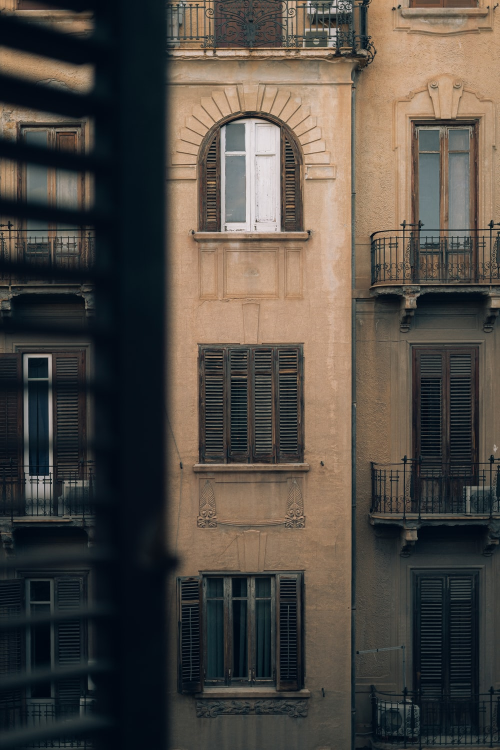 beige building with arch window