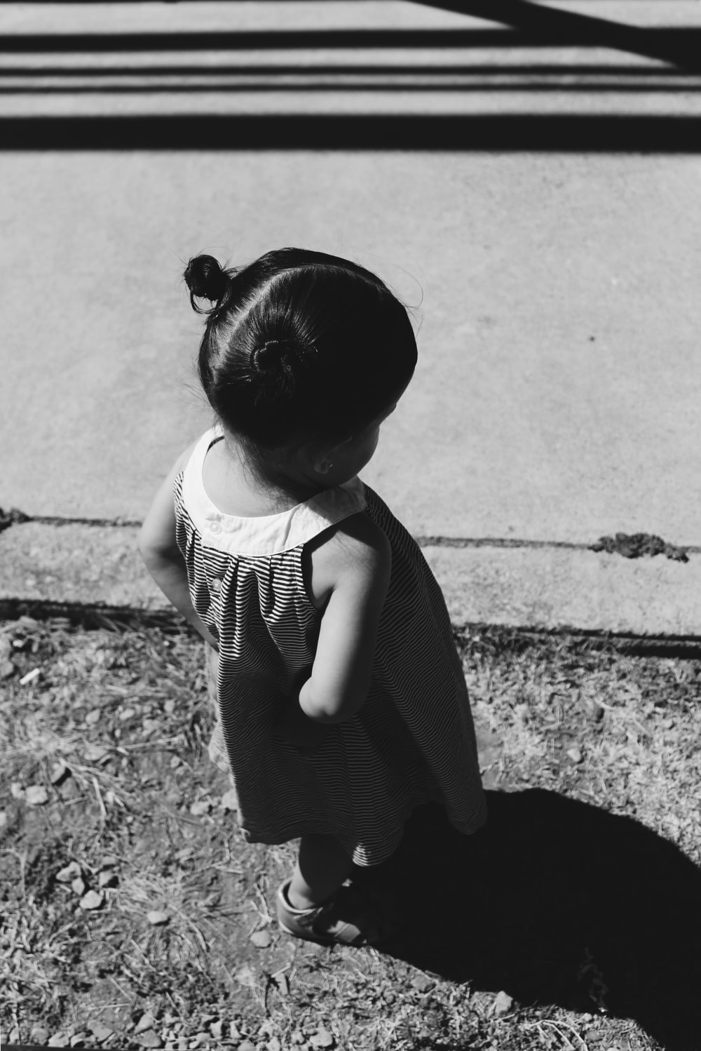 grayscale photo of a girl toddler