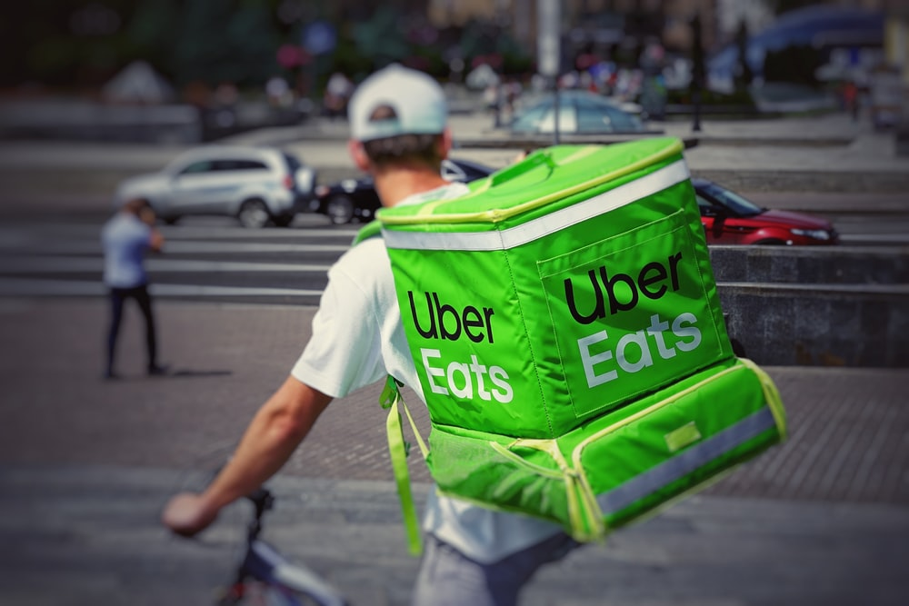 man with Uber eats backpack