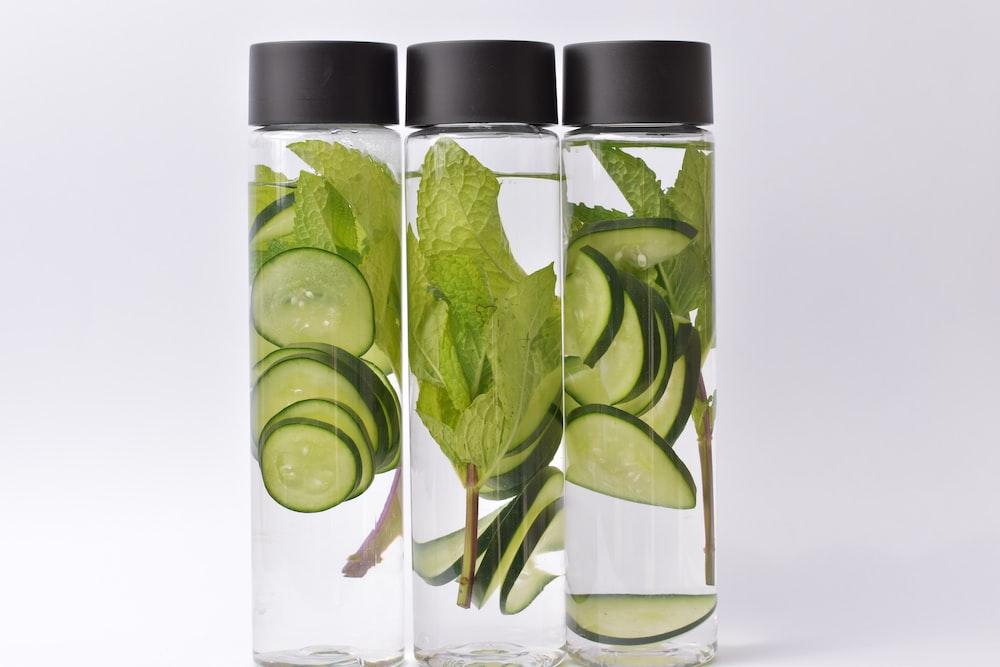 sliced cucumber on jars