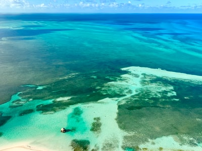 blue and green body of water bahamas teams background