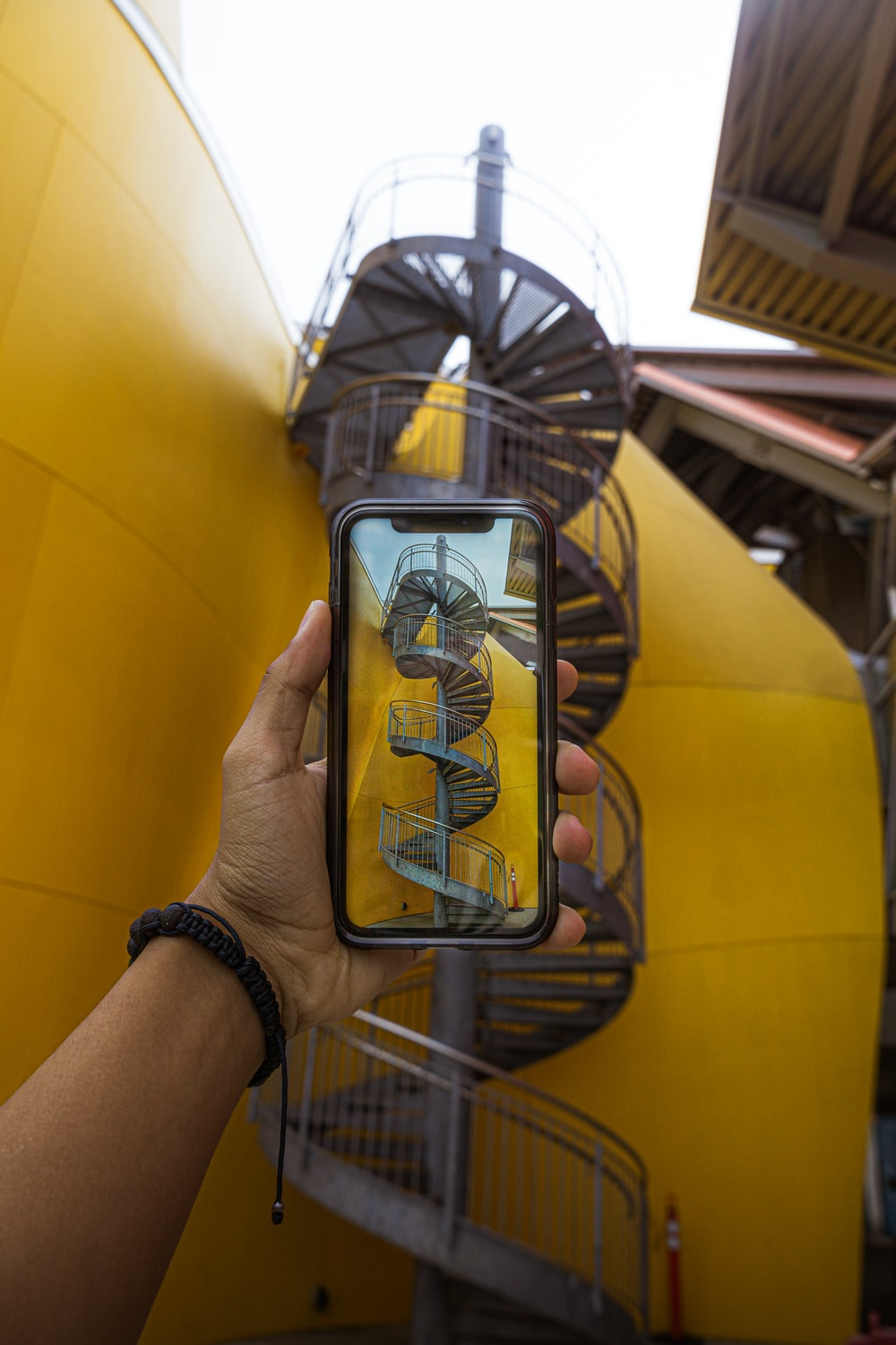 smartphone in front of gray spiral staircase