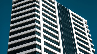 low angle photo of white curtain wall building