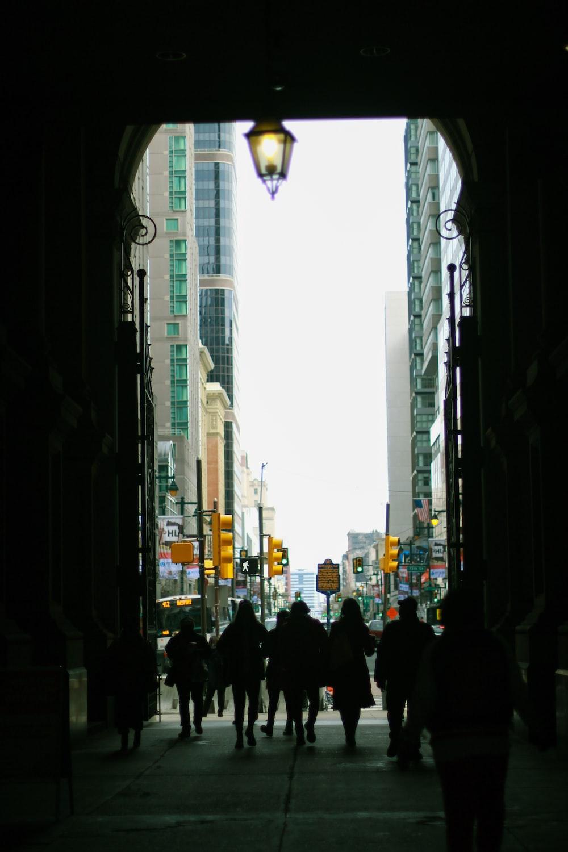 people walking on pathway near high-rise buildings