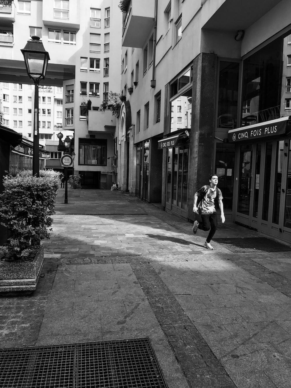 man running near building