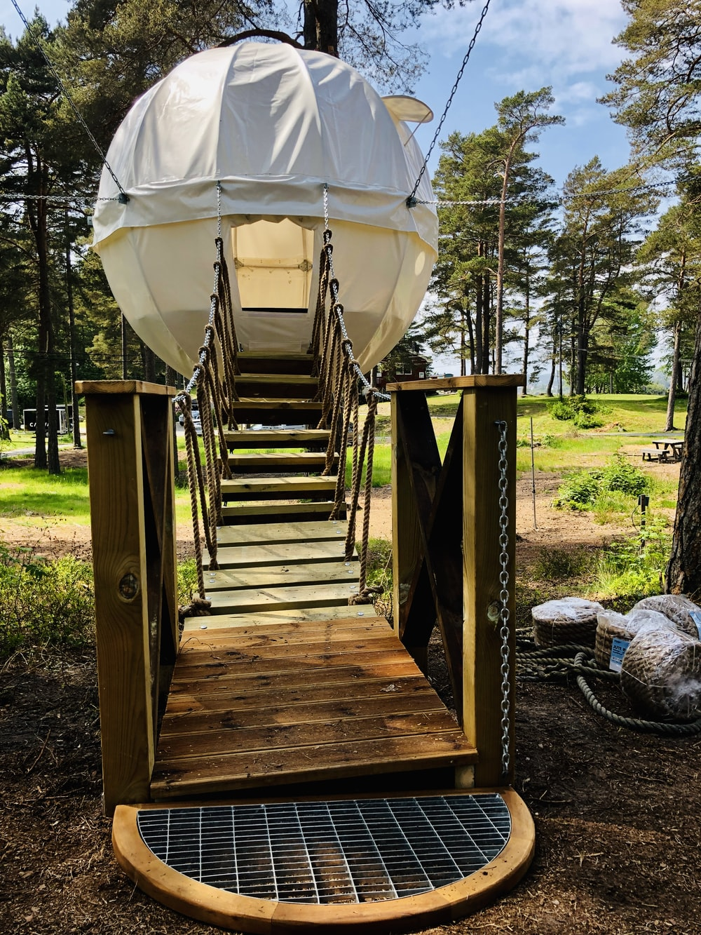 white hanging tent with brown wooden stairs