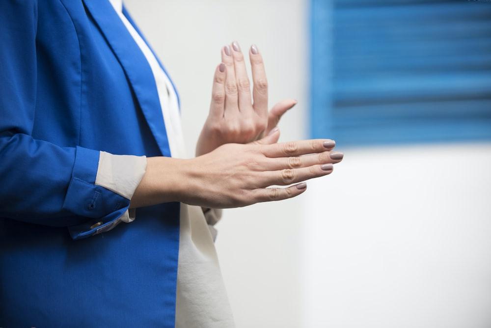 person wearing blue blazer
