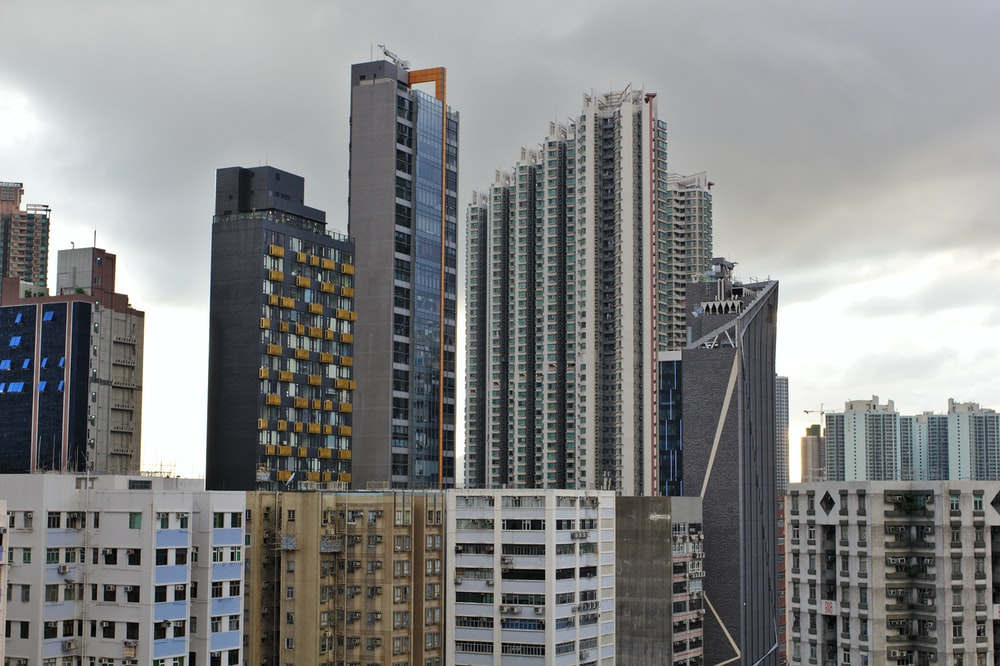 grey clouds hovering over city buildings