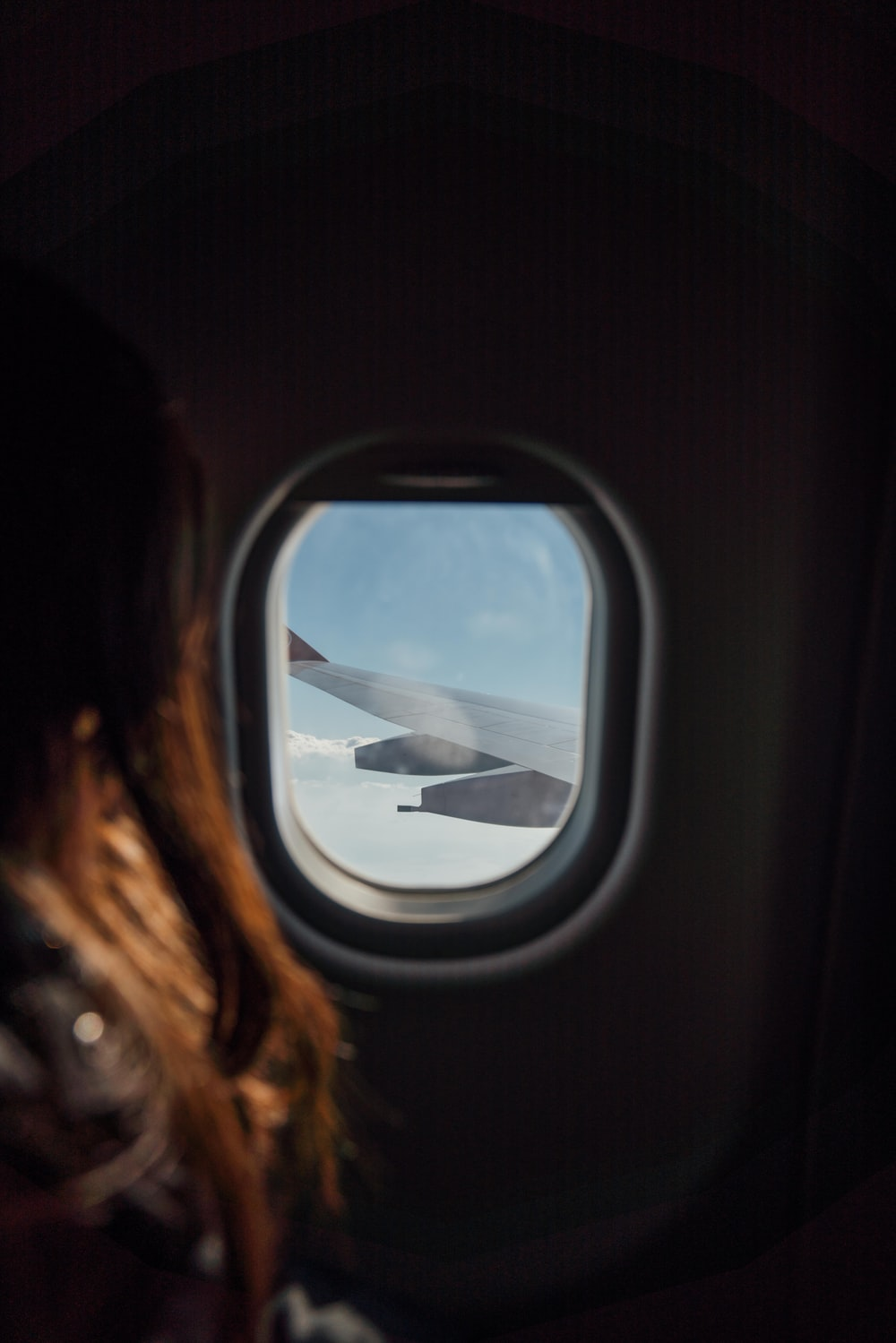 woman sitting beside airplane window