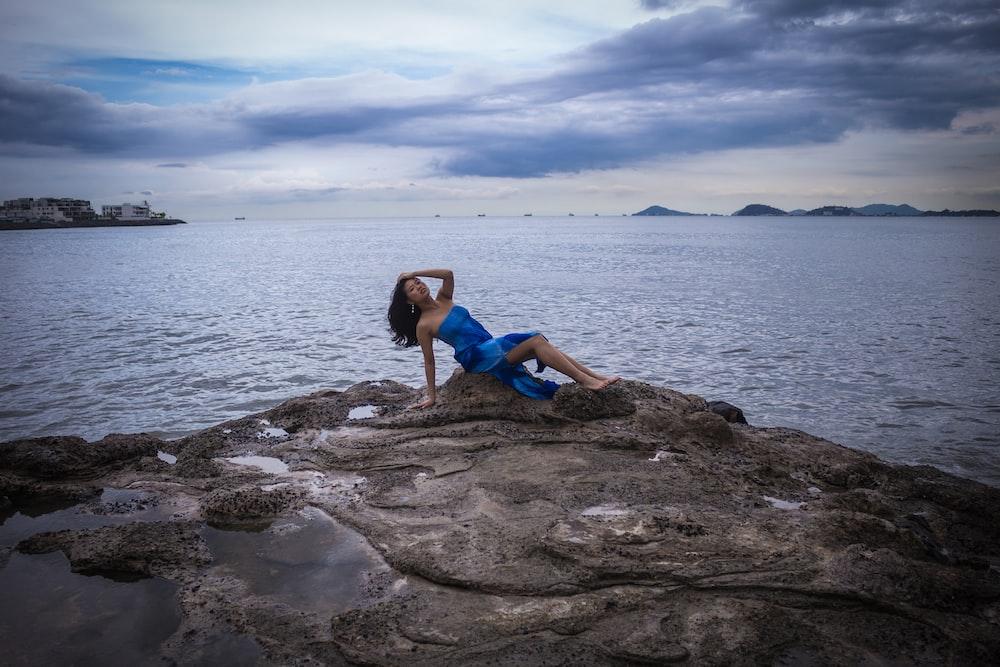 woman sitting on rock fragment
