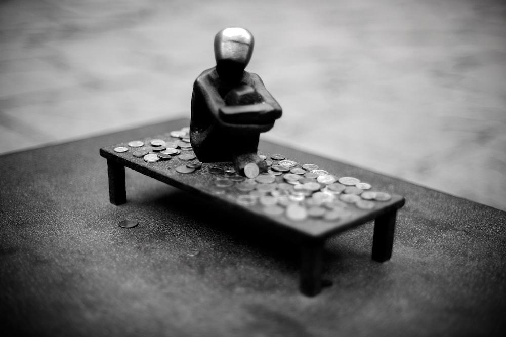 man figure on black table