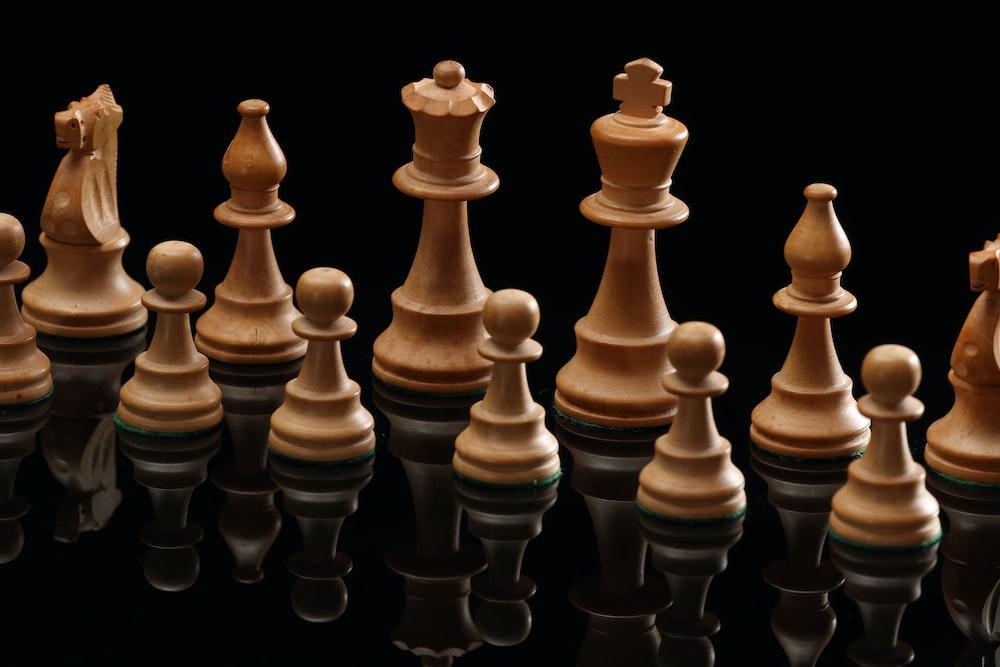 beige wooden chess pieces