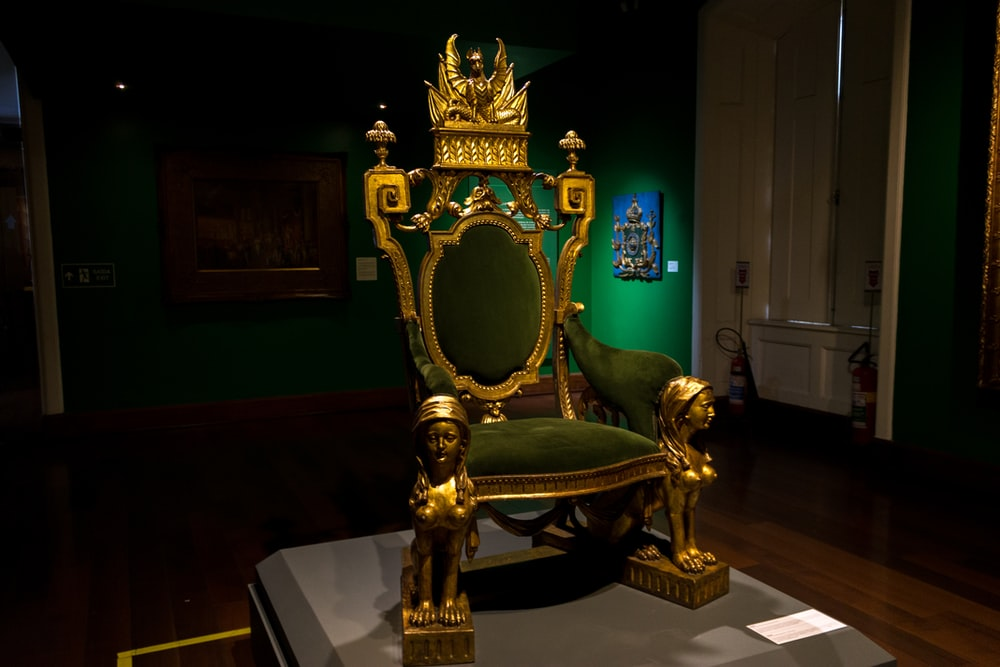 gold and green armchair