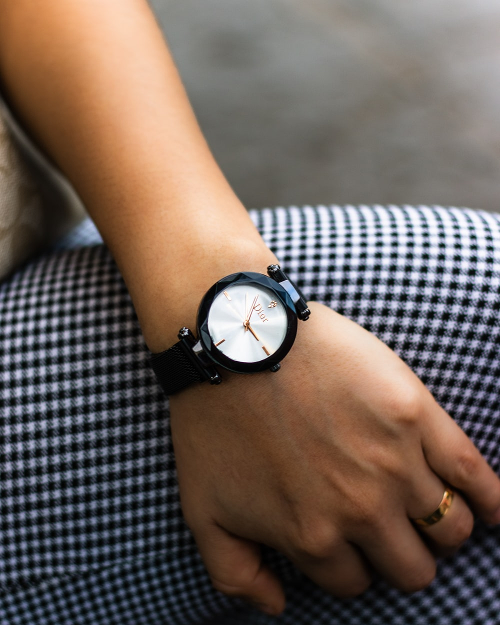 person wearing watch at 11:15