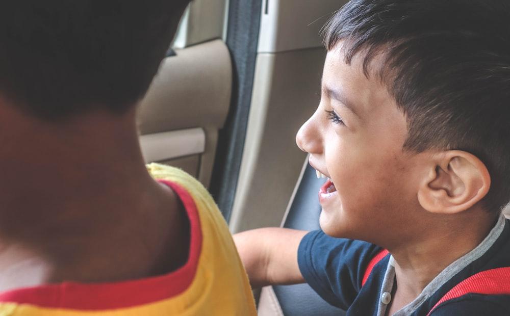 boy sitting inside vehicle