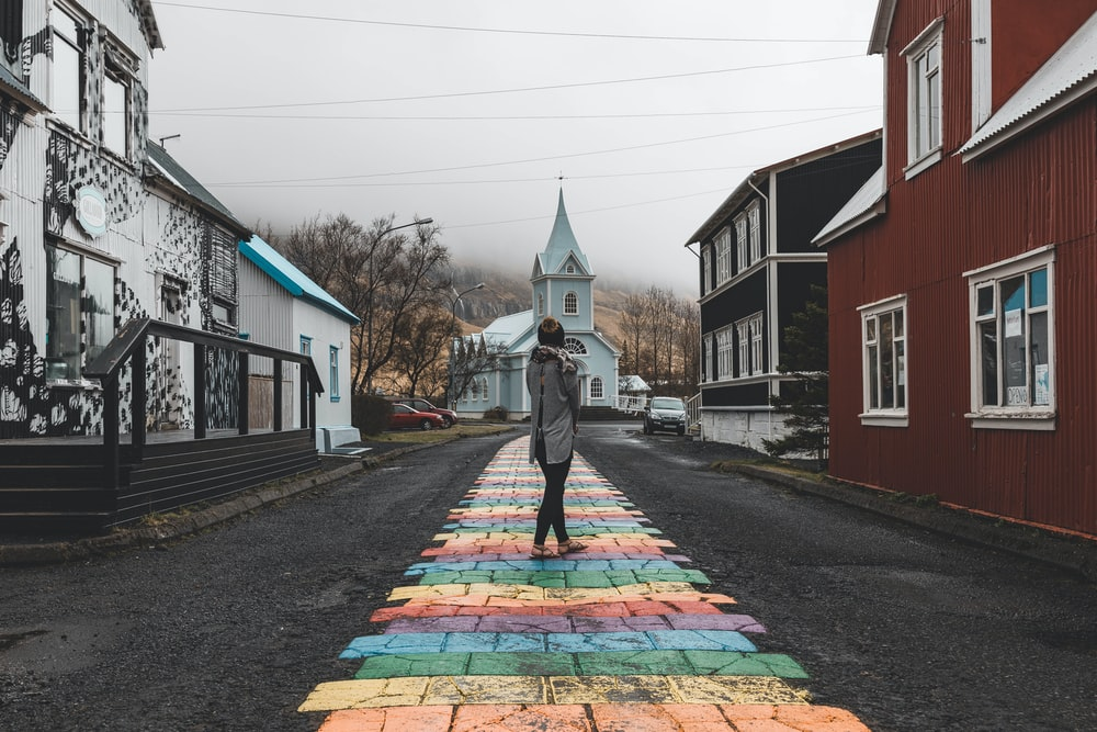 woman standing at middle of road