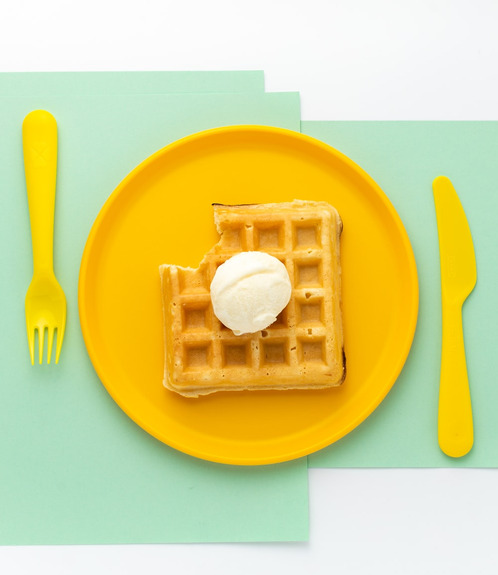 food photography of waffles with vanilla ice cream on top