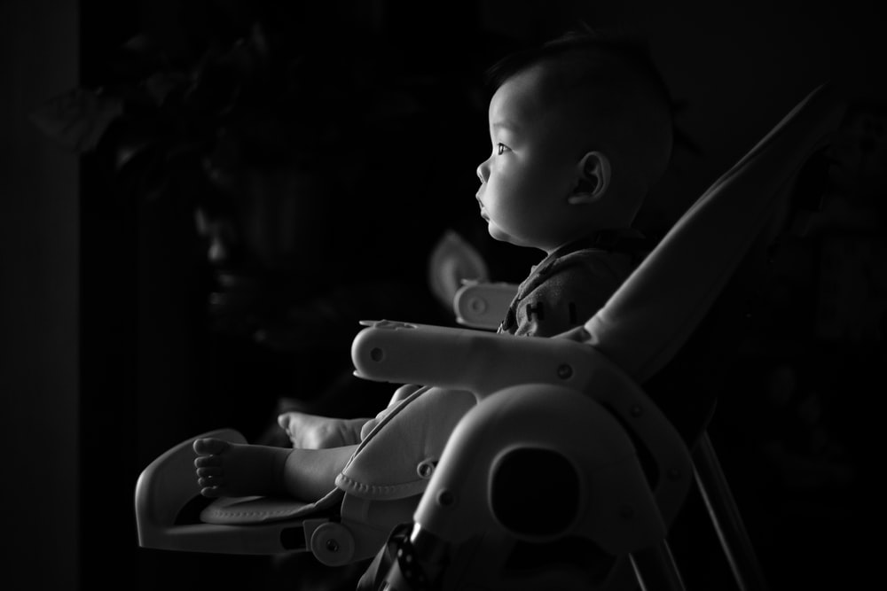 baby seated on bouncer seat