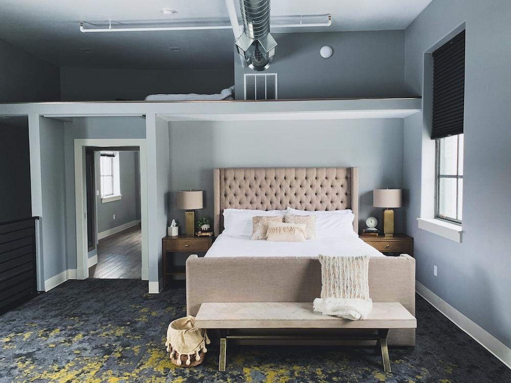 beige bed with mattress