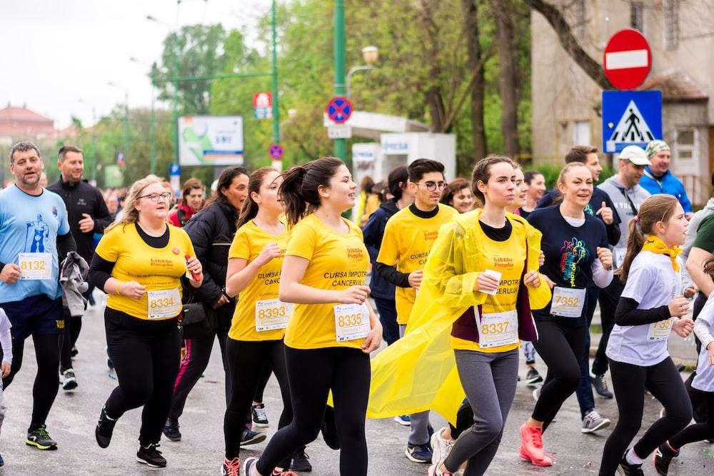 men and women running on street