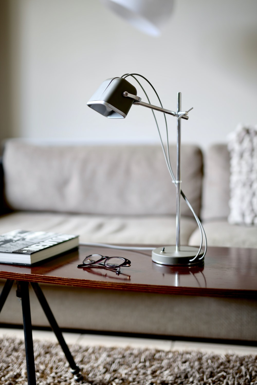 grey study lamp on table