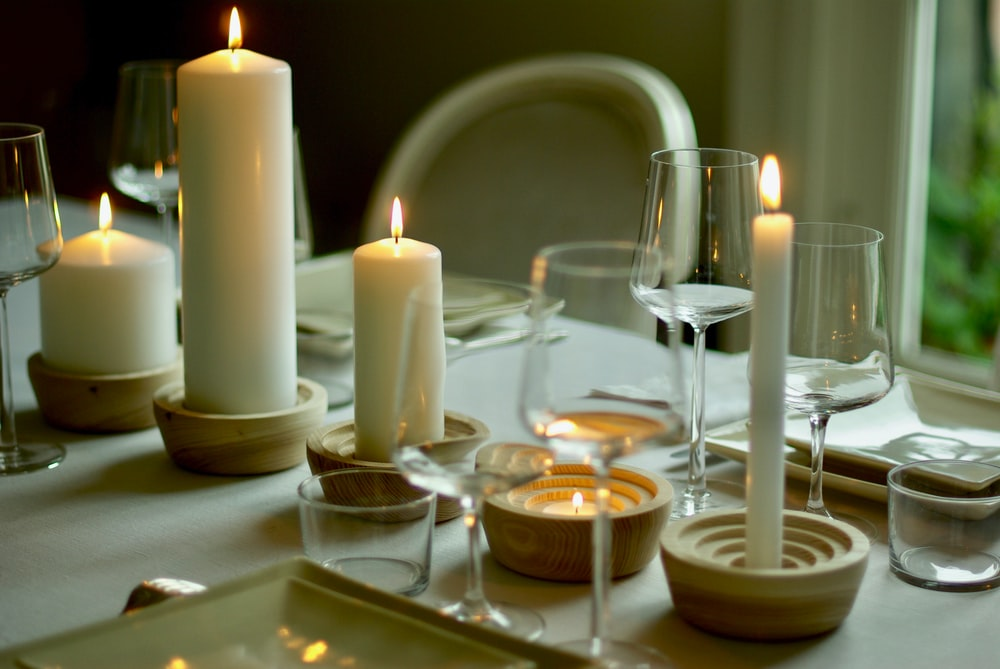 lighted candles on white table