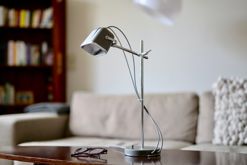 turned-off desk lamp on brown table
