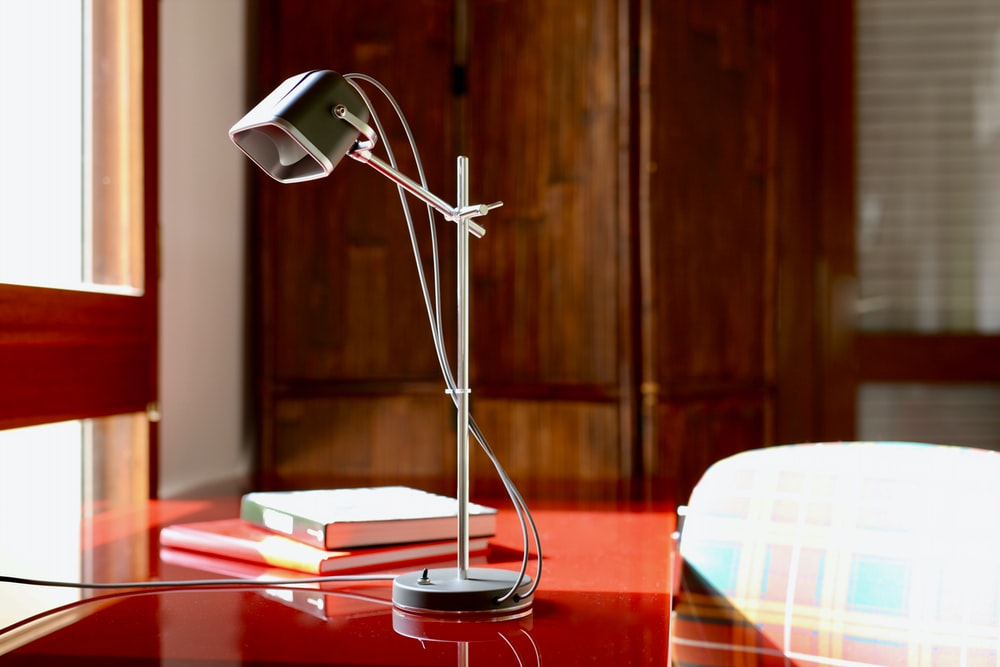 gray study lamp on table