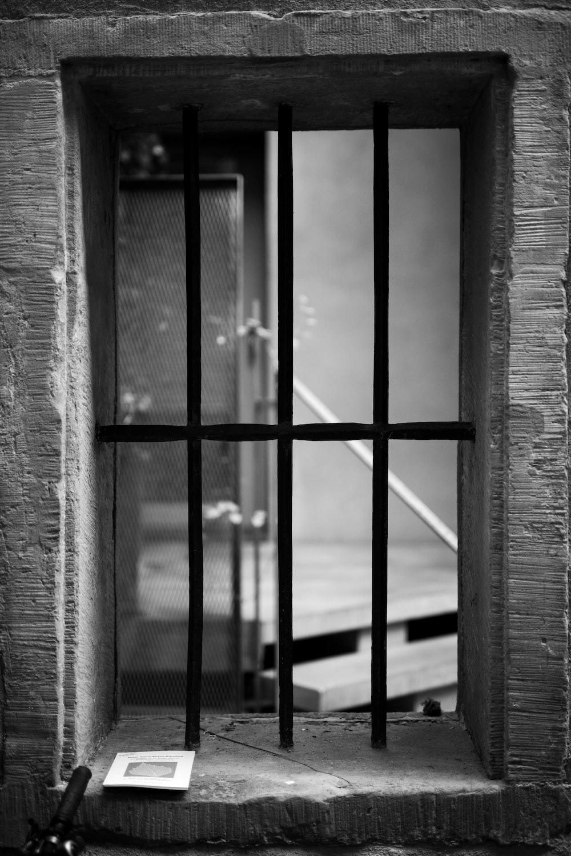 grayscale photography of black metal window