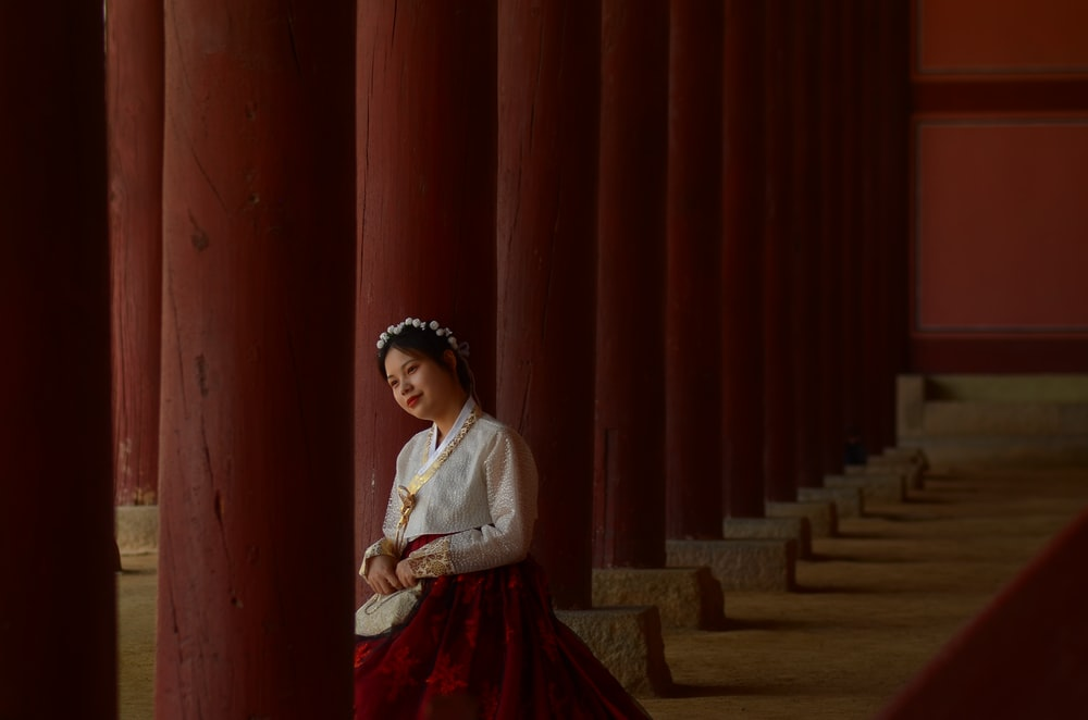 woman wearing red and white hanbok