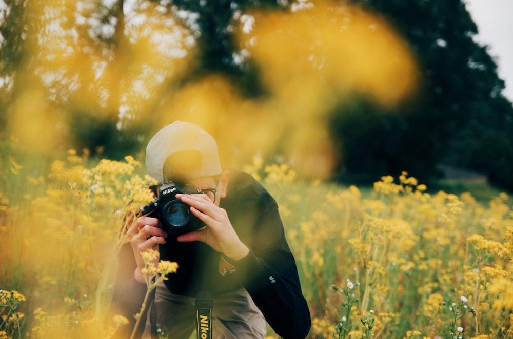 man using Nikon DSLR camera