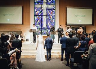 wedding couple standing on aisle