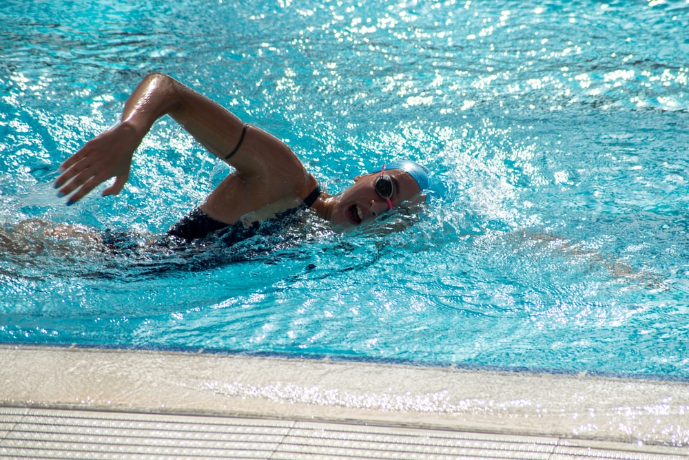 person swimming on pool
