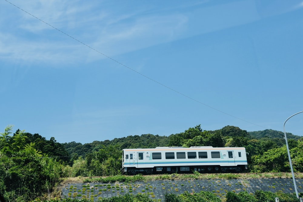 view of white train during daytime