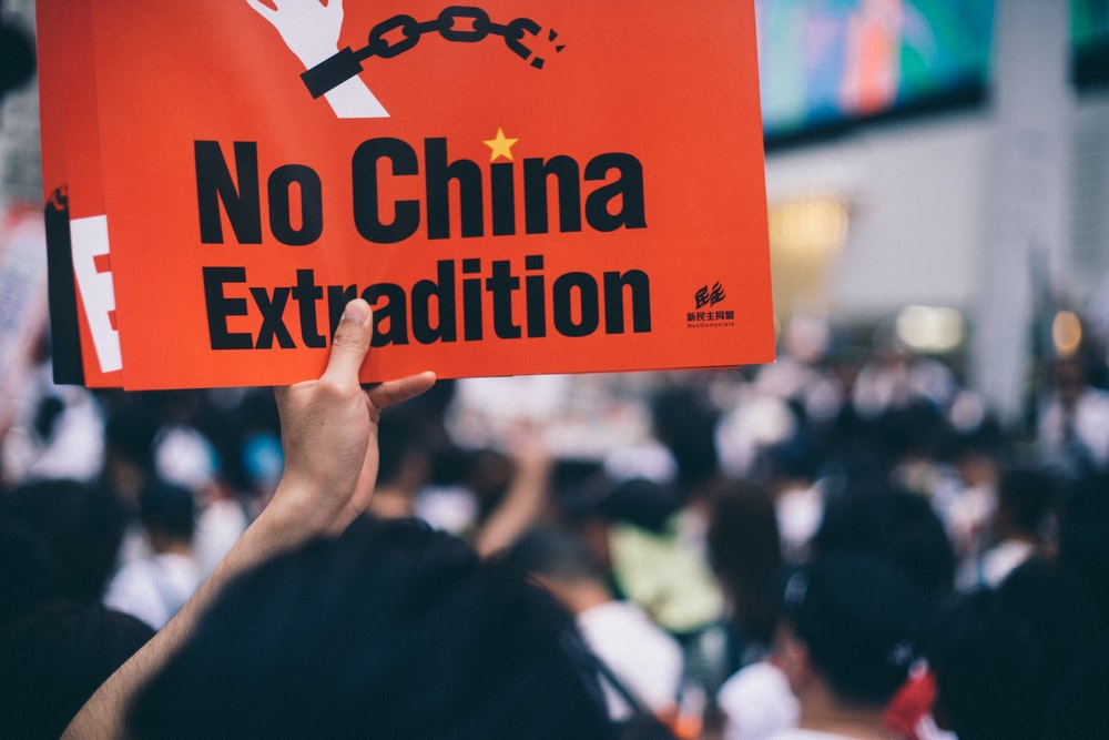 person holding no china extradition poster