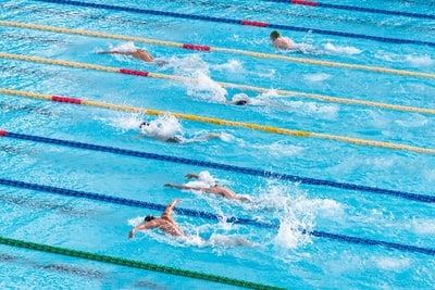 people in swimming pool swimming teams background