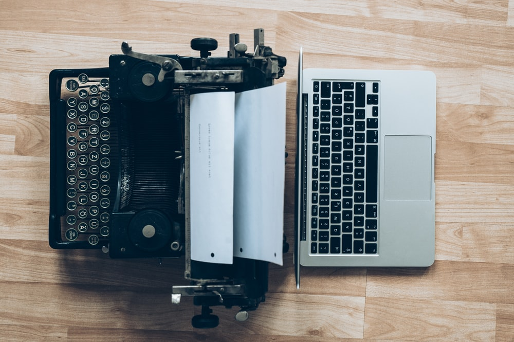 gray typewriter and MacBook