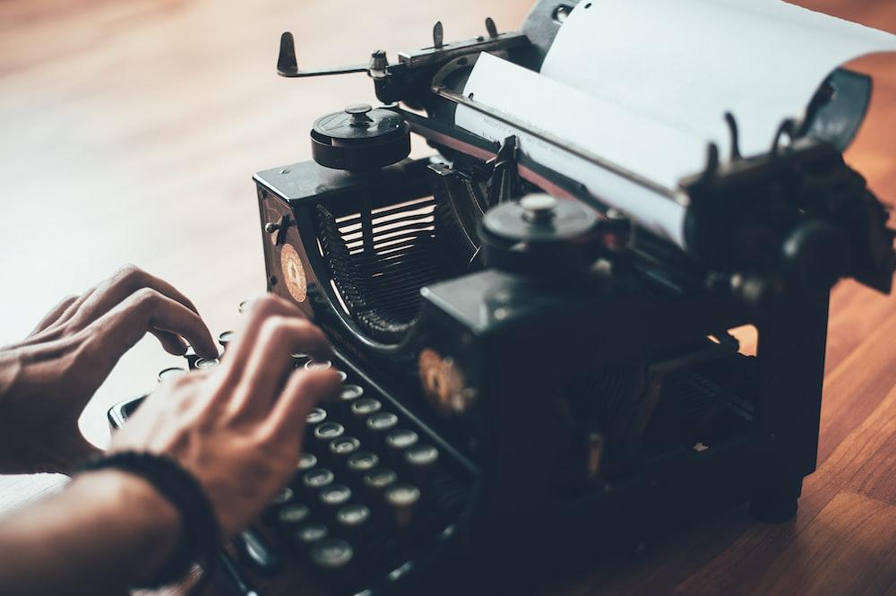 person using typewriter