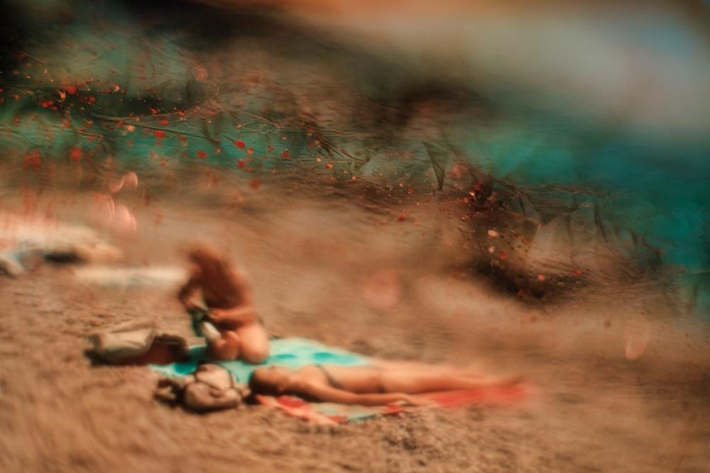 woman lying on sand