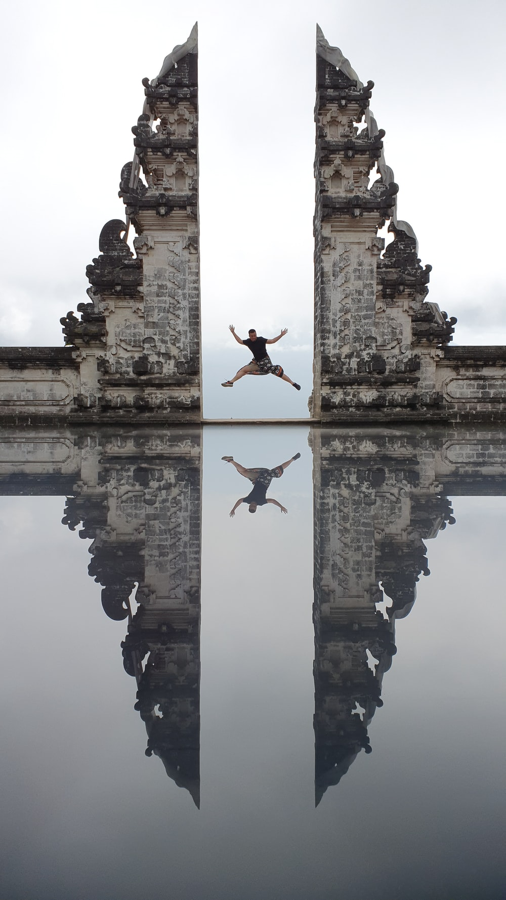person jumping above water