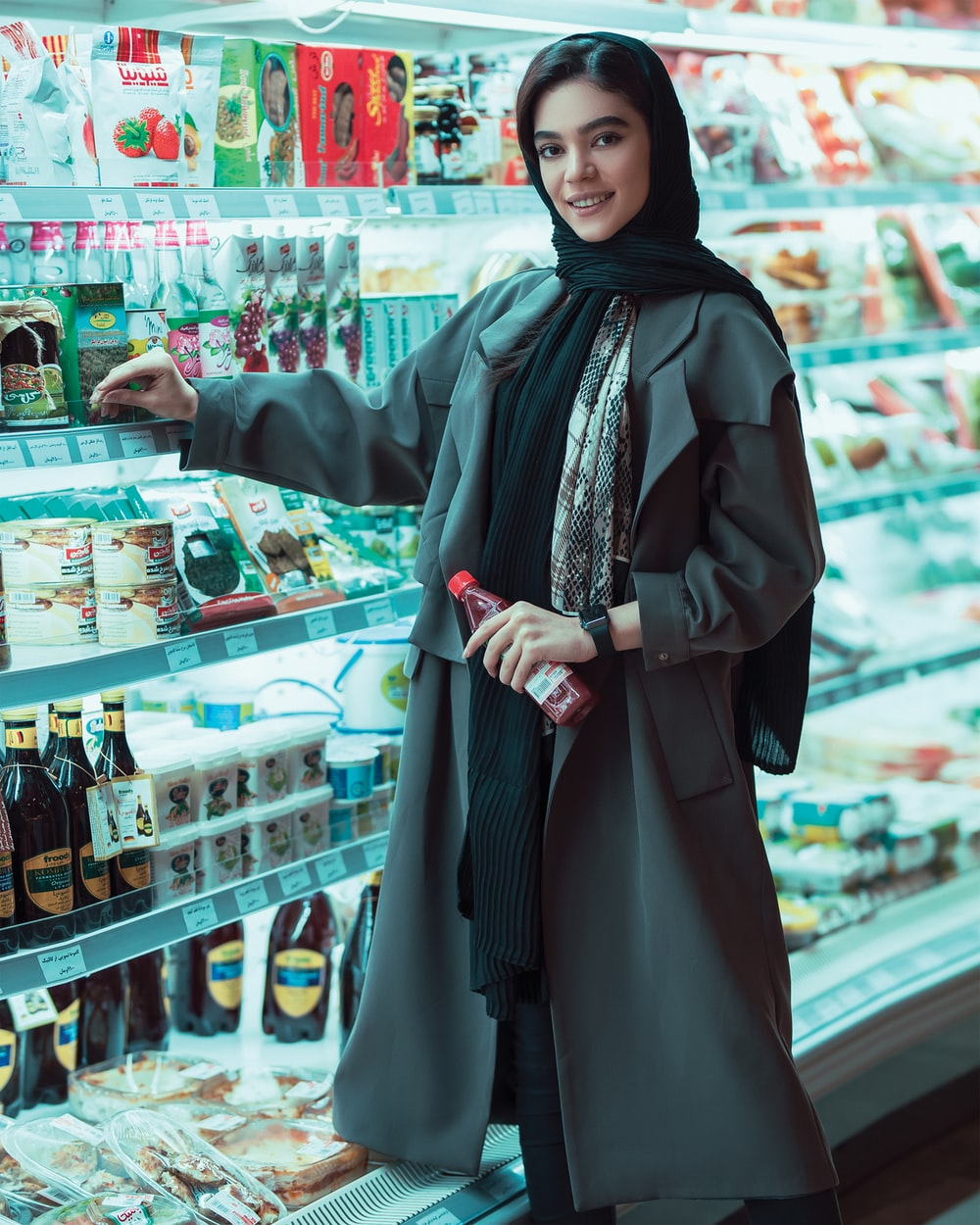 woman wearing black scarf near the refrigerator