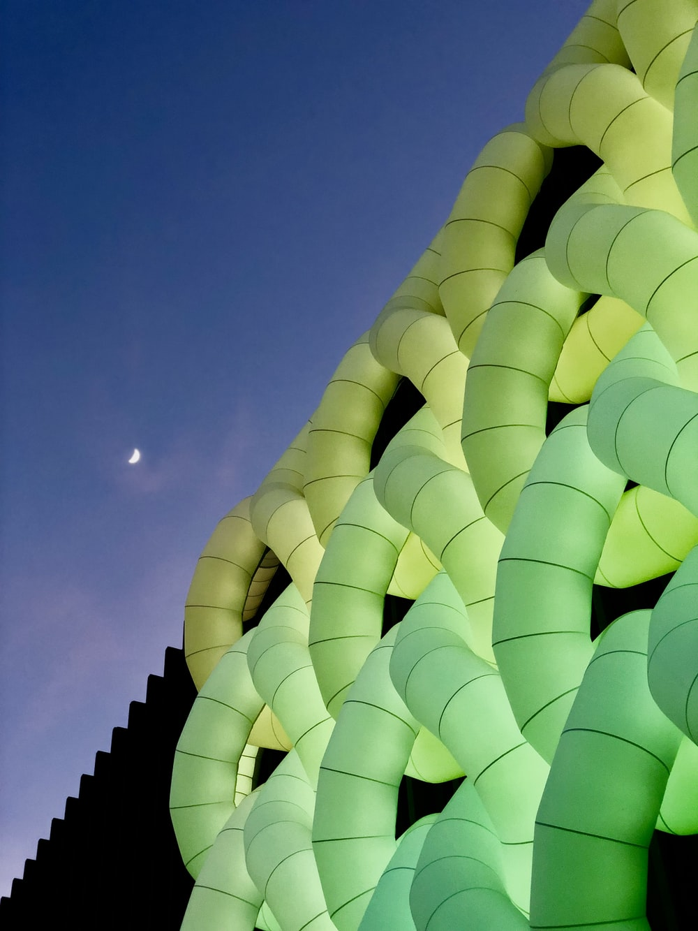 green and yellow inflatable decor under blue skies