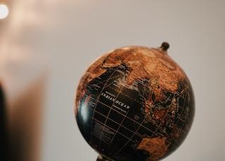 globe on black surface