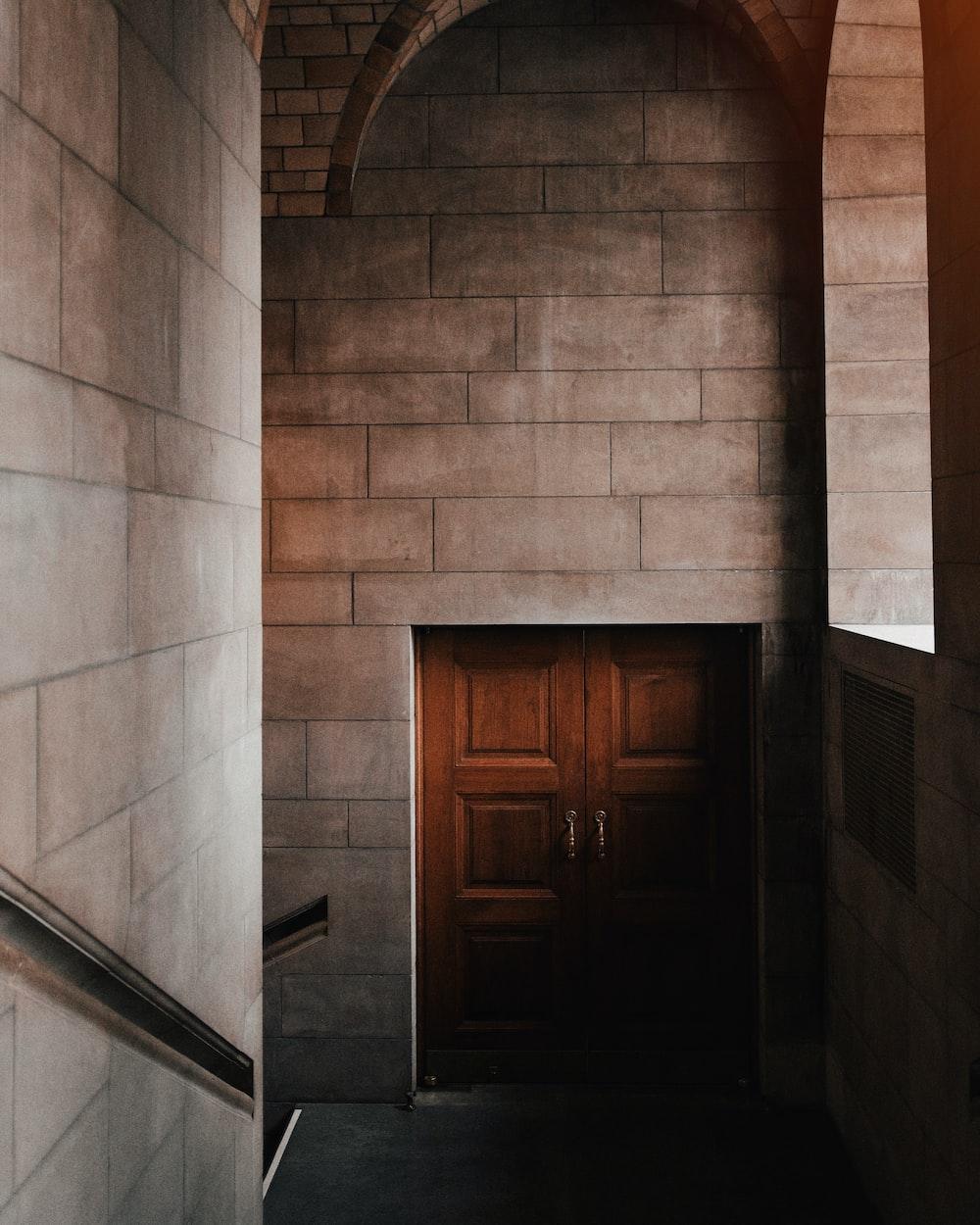 stairs towards brown wooden door