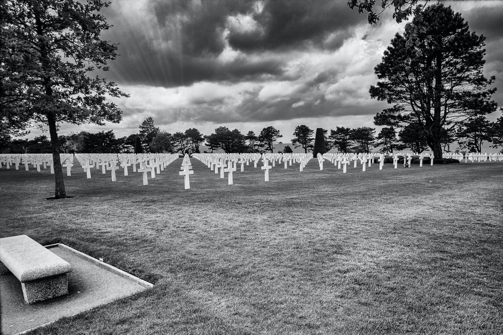 cemetery under cloudy sky