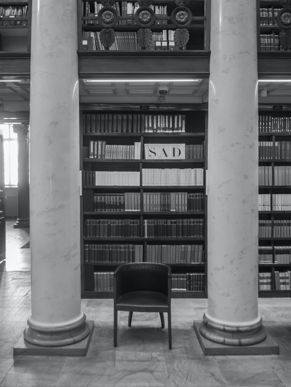 vacant black armchair in library