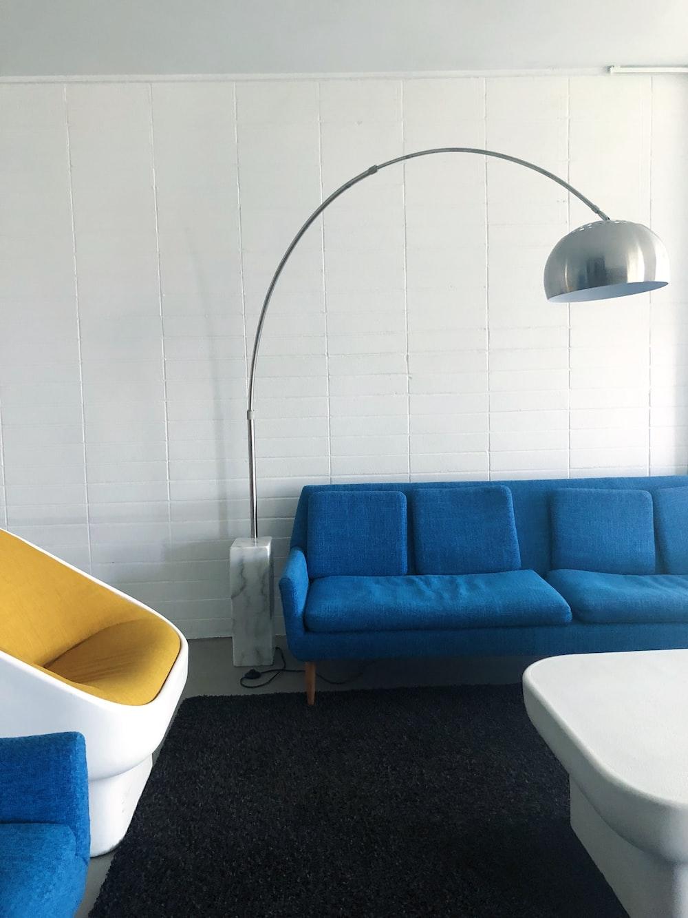 grey floor lamp beside sofa